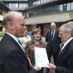 Tony Burton hands over the Carno Transport Appraisal to Councillor Gwilym Evans, Chairman of TraCC outisde County Hall