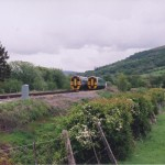 rackside view of trains passing at Talerddig loop - looking East